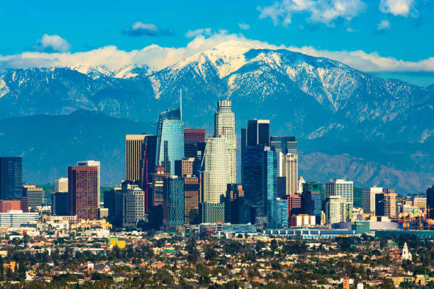 Los Angeles Skyline With A New Skyscraper And With Snow-capped Mountains stock photo