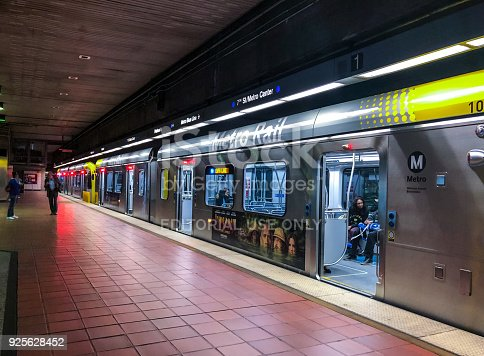 Los Angeles, December 26, 2017: Los Angeles Subway station platform with people leaving train. Expo Line Metro station from Santa Monica to Los Angeles, California, USA. It's recently opened extension of the Metro Rail System connecting Santa Monica to LA downtown.