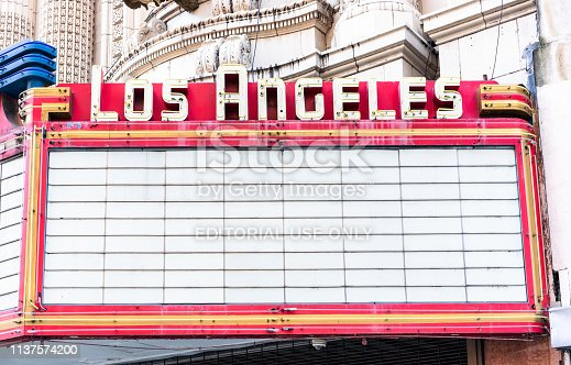 Los Angeles, USA - A large billboard for show information at the Los Angeles Theater in LA's historic core district.