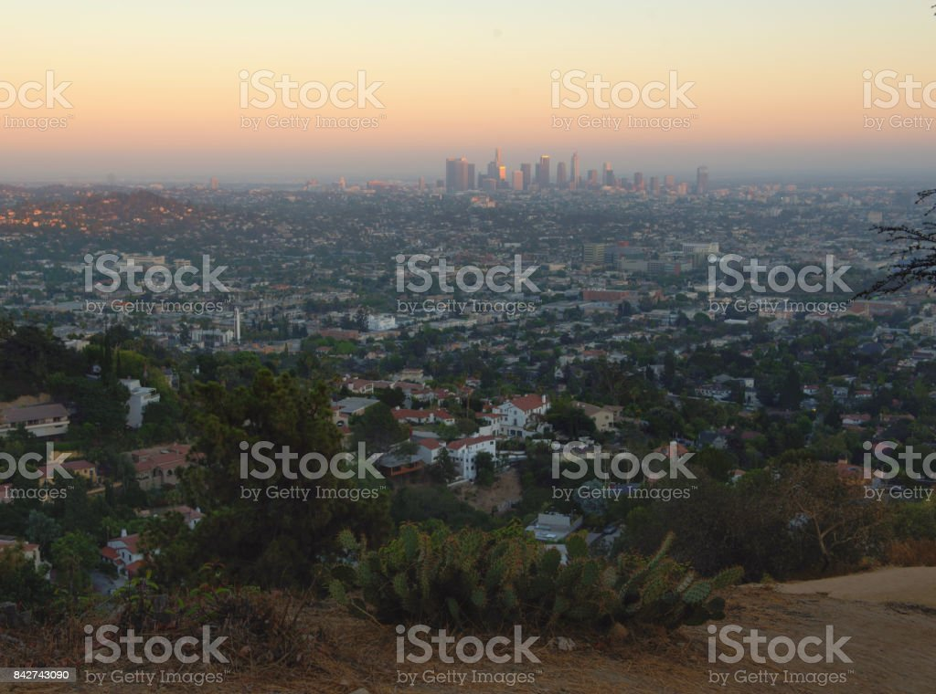Los Angles City at sunset with hill foreground, California, USA stock photo