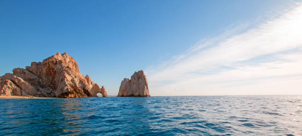 Los Arcos / The Arch at Lands End as seen from the Pacific Ocean at Cabo San Lucas in Baja California Mexico BCS Los Arcos / The Arch at Lands End as seen from the Pacific Ocean at Cabo San Lucas in Baja California Mexico BCS natural arch stock pictures, royalty-free photos & images