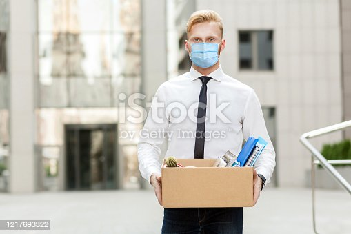 lose job, Youre fired. Unhappy business man with surgical medical mask going out with cardboard, looking at camera and feeling looser. Outdoor shot. business, working and health care concept.