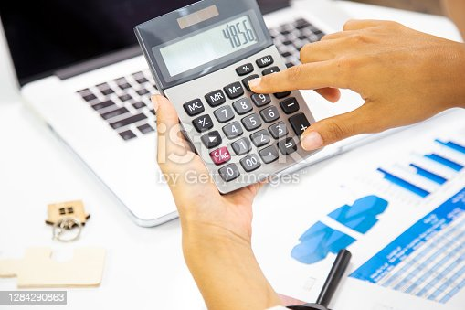 lose up Business woman using calculator and laptop for do math finance on wooden desk in office and business working background, tax, accounting, statistics and analytic research concept
