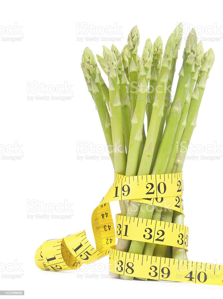 Lose weight concept, Asparagus with tape royalty-free stock photo
