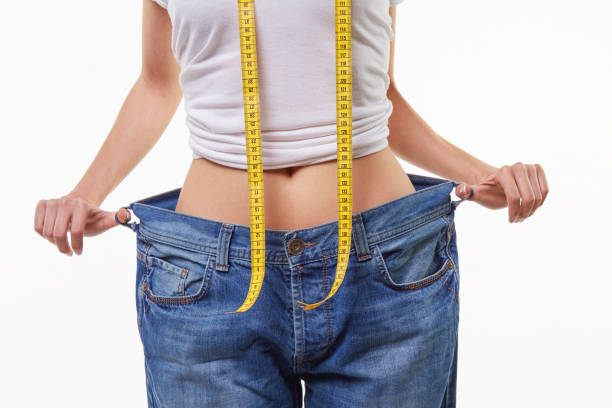 lose weight Cute and beauty young woman losing weight. dieting stock pictures, royalty-free photos & images