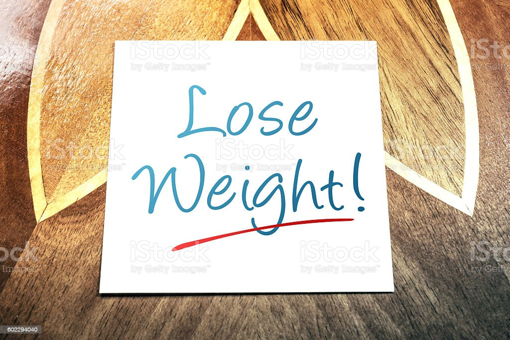 Lose Weight Reminder On Paper Lying On Wooden Table stock photo