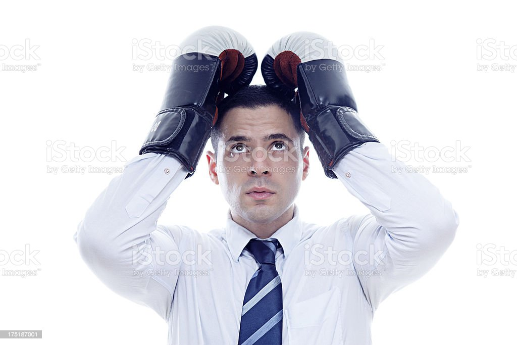 Loser businessman covers his head with boxing gloves royalty-free stock photo
