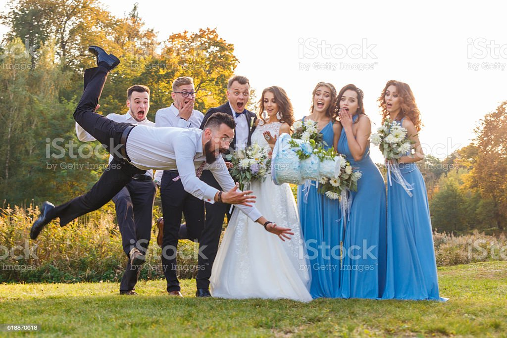 Loser drops the wedding cake stock photo