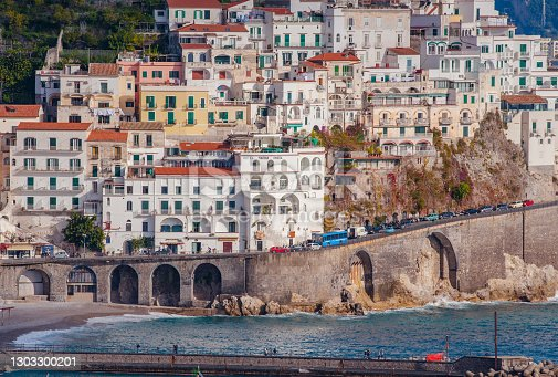 lose-up of  beautiful white houses Amalfi on hills leading down to coast, Campania, Italy. Amalfi coast is most popular travel and holiday destination in Europe.