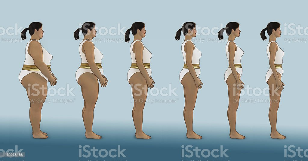 Losing weight in white bathing suit and golden belt stock photo