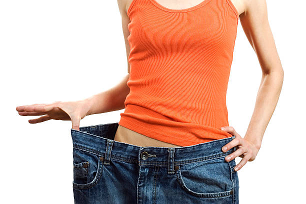 gewichtsabnahme - damen sporthose übergröße stock-fotos und bilder