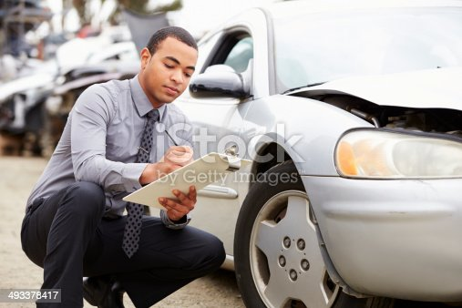 istock Loss Adjuster Inspecting Car Involved In Accident 493378417