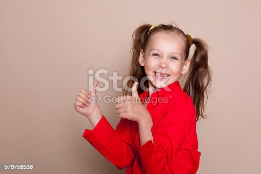 istock loss of primary teeth the girl smile 579758536