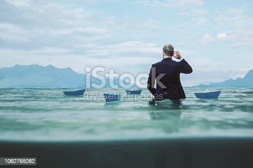 Lost and confused businessman in water.