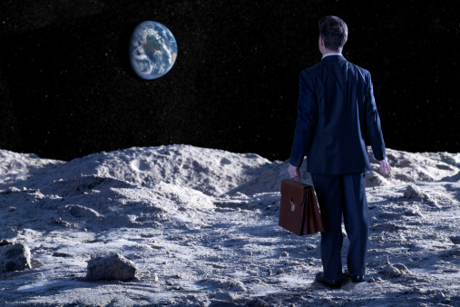 A stunning image of a lost, confused, desperate businessman over the moon surface, looking at distant planet earth.