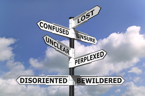 Lost And Confused Signpost Stock Photo - Download Image Now