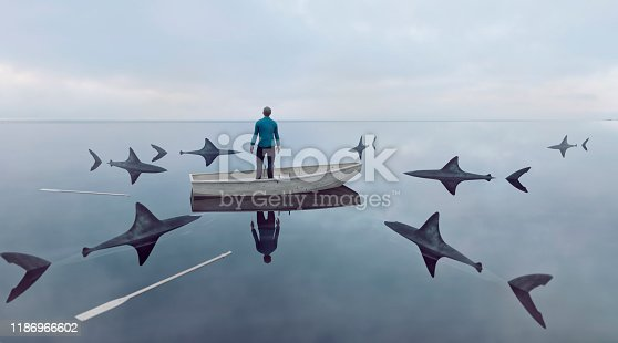 Man lost at sea in row boat made of wood. He has lost the oars and cannot sail the boat. Sharks are moving in on him. He stands up in the boat looking for a way out. Concept of failure and trying to find a solution to an emerging problem.  Note: The man is a 3D-render. Property release attached.