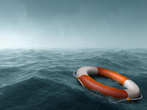 Lost at sea Lifebuoy floating in the vast expanse of sea buoy stock pictures, royalty-free photos & images