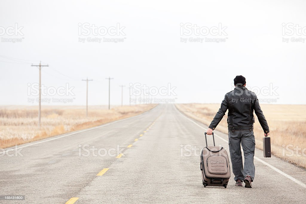 Lost Business Traveler on Desolate Highway royalty-free stock photo