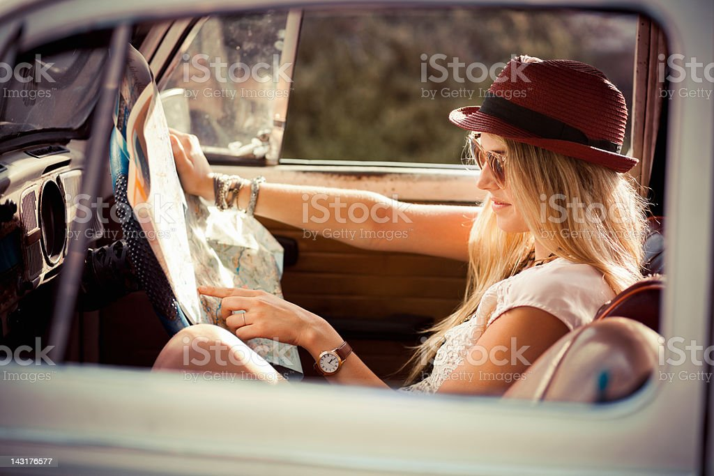 Lost Female Hipster Reading Map In the Car royalty-free stock photo