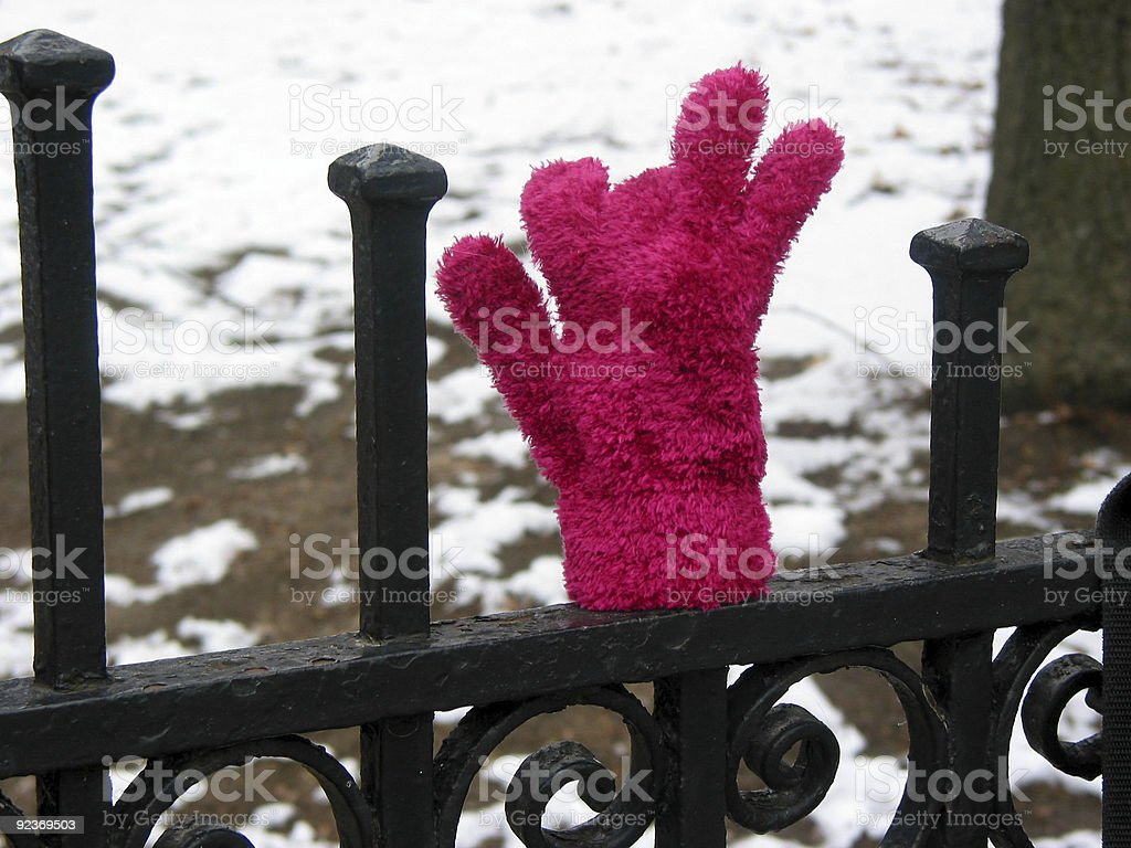 Lost glove on fence royalty-free stock photo