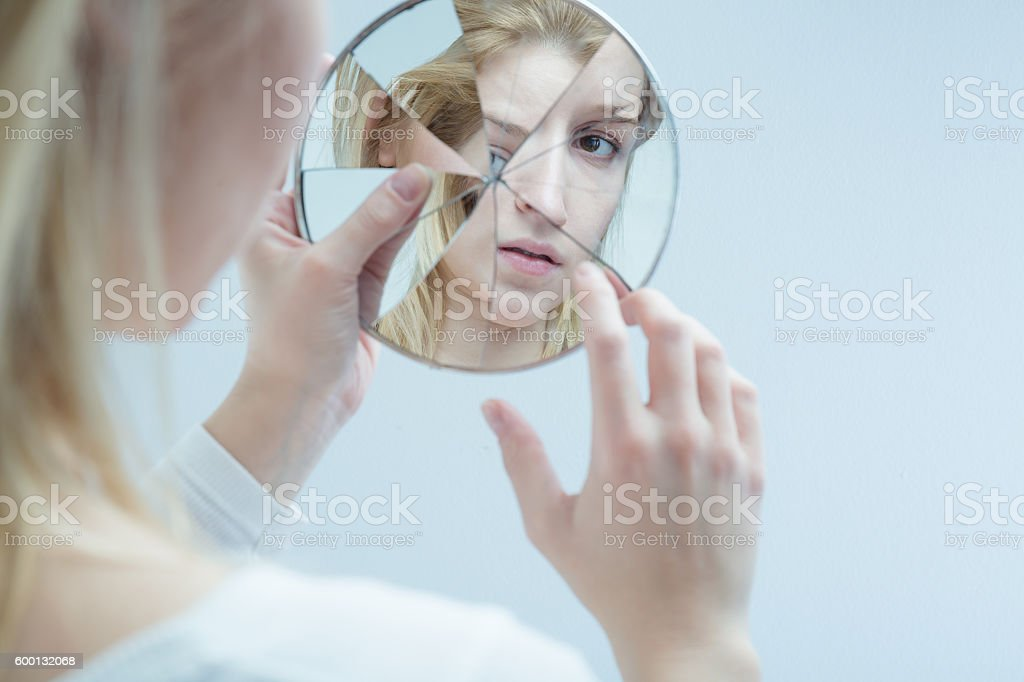 Lost herself in everyday difficulties stock photo