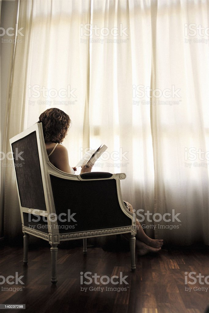 Lost in a good book 2 royalty-free stock photo