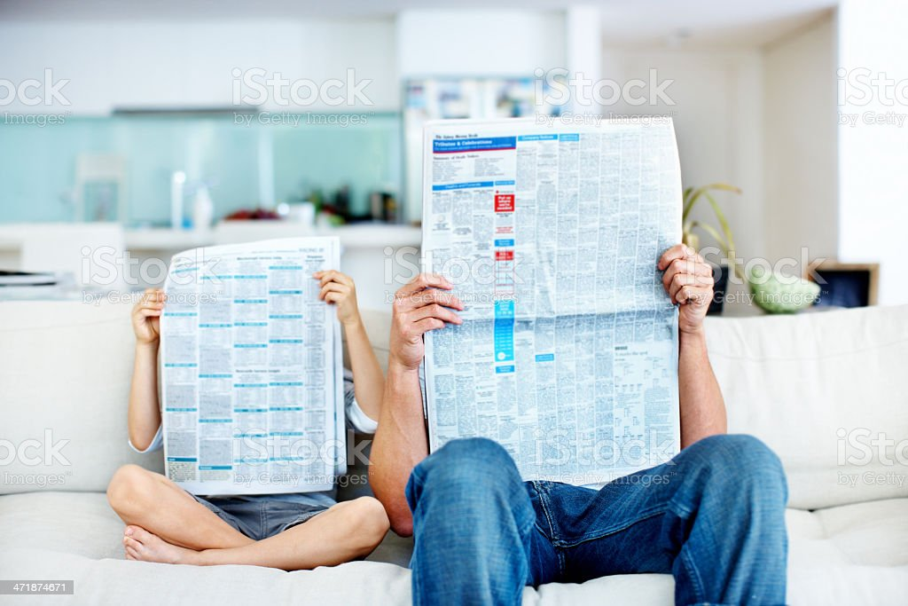 Lost in their reading stock photo