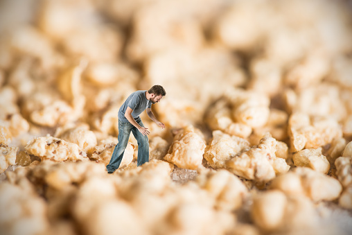 Lost man in micro world of sugar and cereal flakes