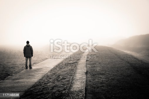 lonely man loosing the way on a foggy day.