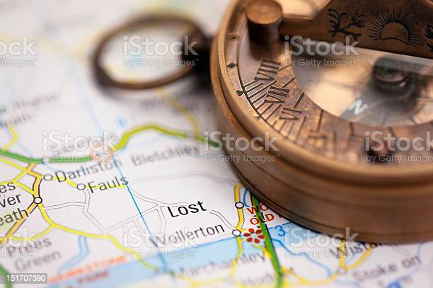 Lost On The Map Travel Concept With Compass Stock Photo - Download Image Now