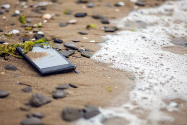 Lost Phone In The Sea stock photo