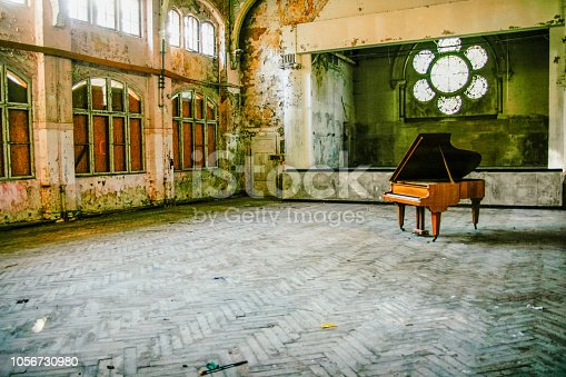 Rotten Ballroom with piano in the middle