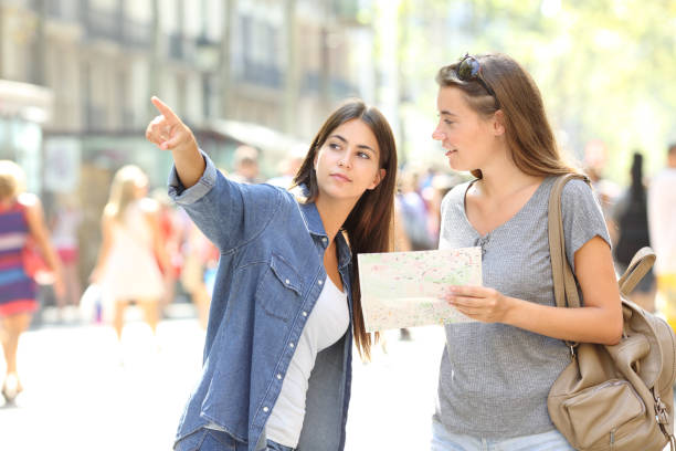 lost tourist asking for help from a pedestrian - europe points imagens e fotografias de stock