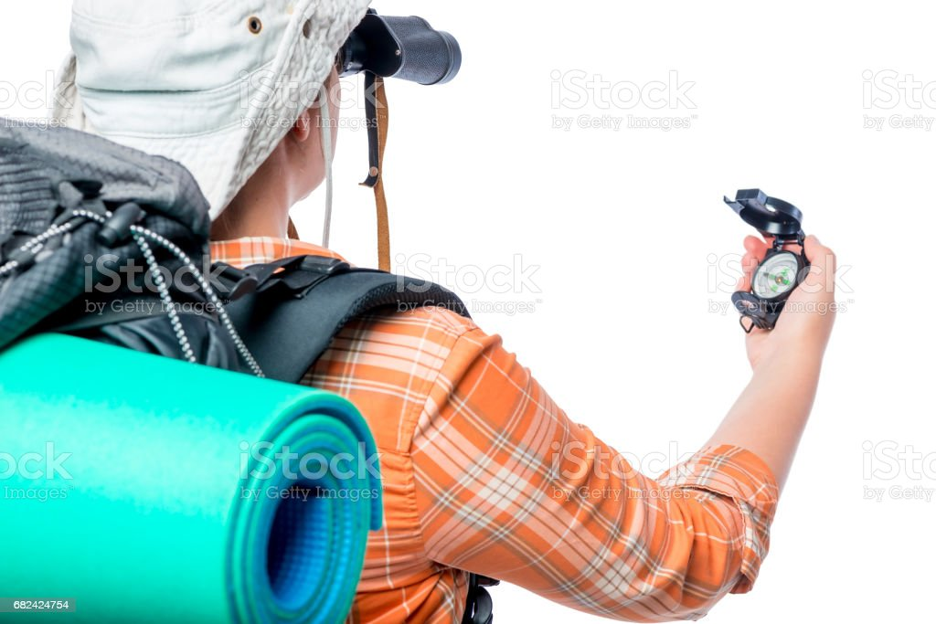 Lost tourist with a compass hand on a white background royalty-free stock photo