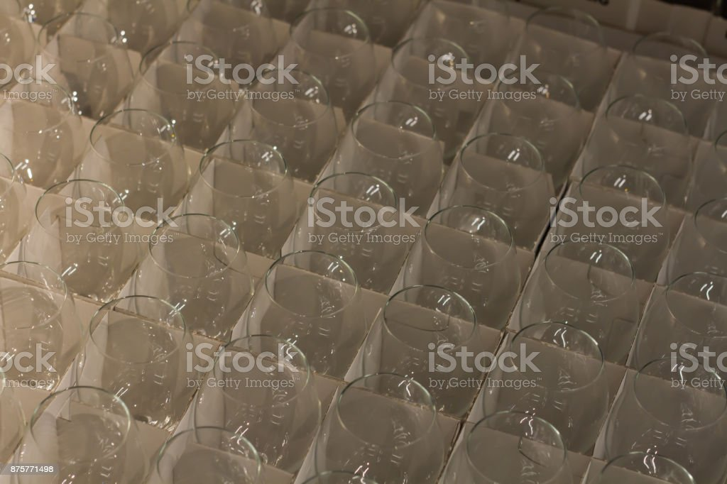 lot clear wine glasses stored in a cardboard box in the warehouse stock photo