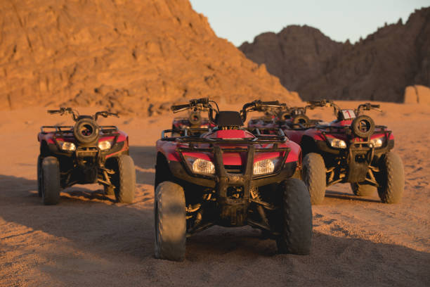 A lot of ATV in sunrise morning in Egypt desert A lot of ATV in sunrise morning in Egypt desert quadbike stock pictures, royalty-free photos & images