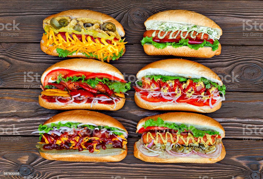 lot of big delicious hot dogs with sauce and vegetables stock photo