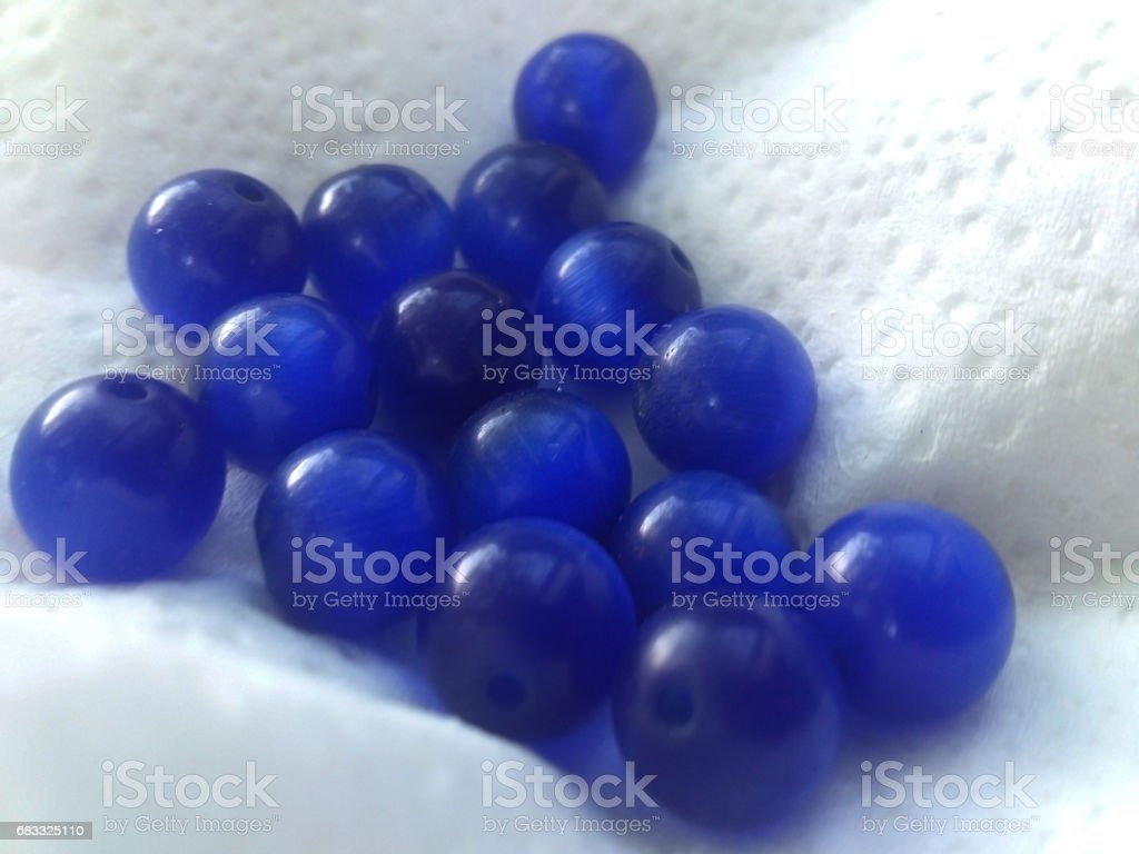 A lot of blue beads on a white background. royalty-free stock photo