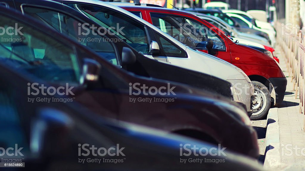 Lot of cars parking in the city, view side stock photo