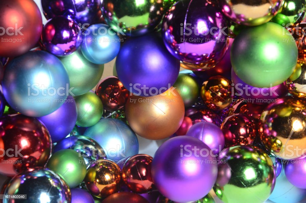 Full frame abstract view of a lot of Christmas baubles in many...