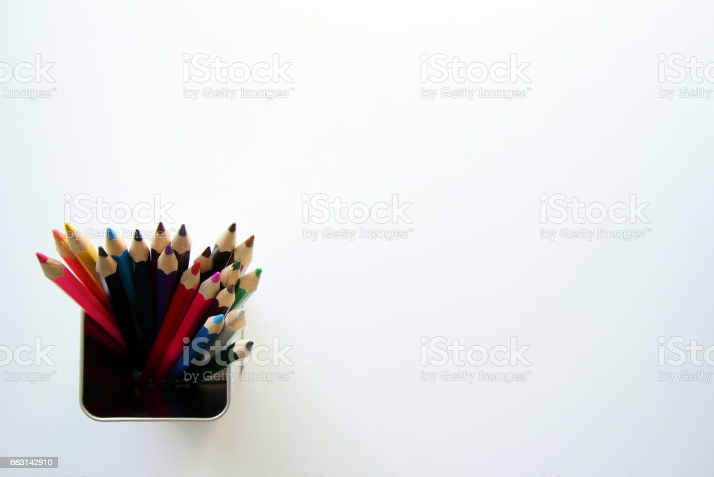 A lot of colored pencils inside a tin can on the white background. royalty-free 스톡 사진
