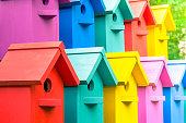 A lot of colorful birdhouses. Houses for birds.