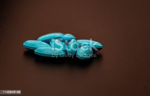 1087546614istockphoto A lot of colorful medication and pills from above 1145849156
