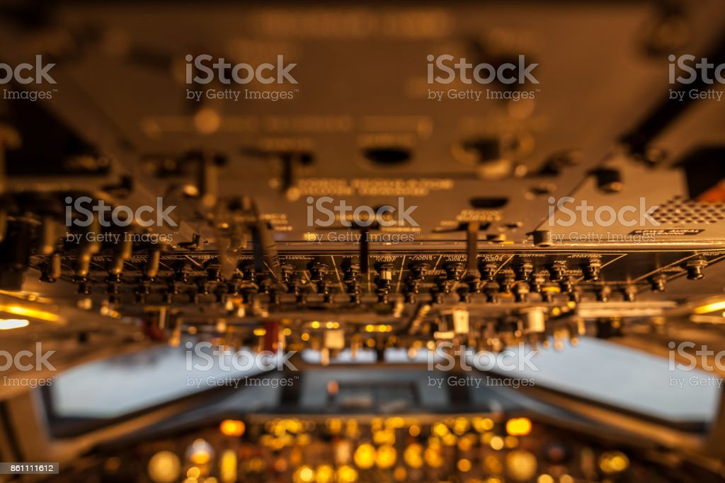 A lot of control levers in aircraft cockpit with selective focus stock photo