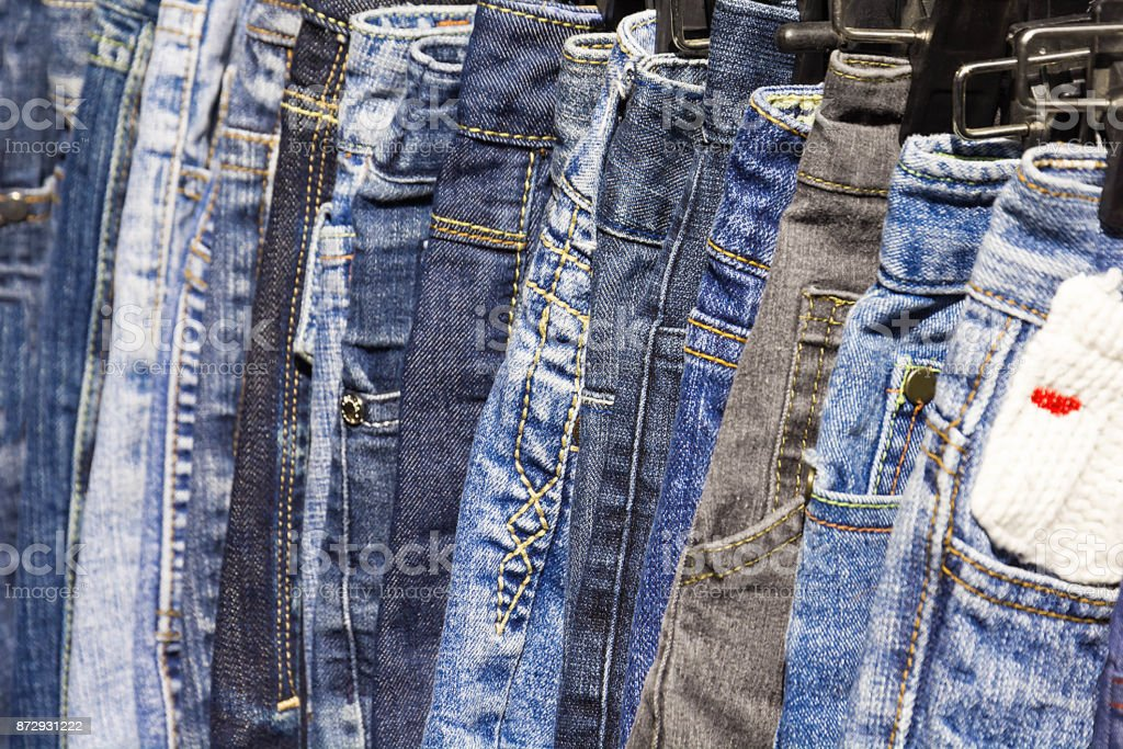 Lot Of Different Blue Jeans stock photo