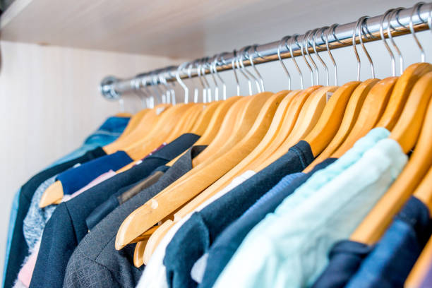 Lot of different clothes on hangers. Copy space stock photo