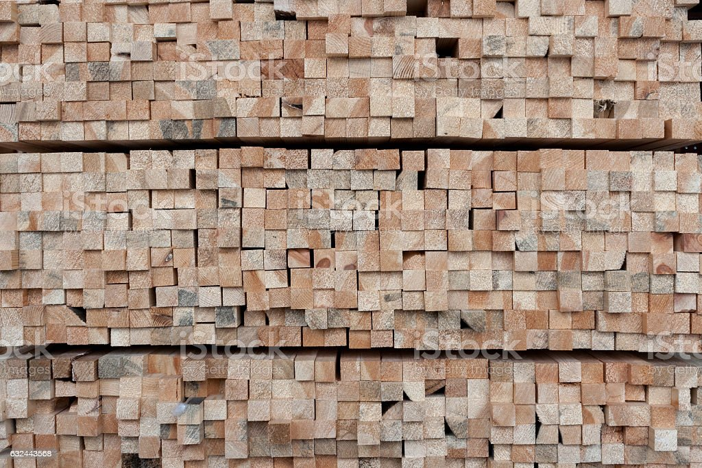 A lot of ends of square section wooden pine bars. stock photo