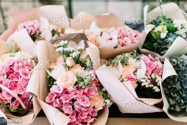 Lot of flower bouquets at the florist shop on the table made of picture id1159802579?b=1&k=6&m=1159802579&s=612x612&h=danm3rr6dyohgpxbjp8ztmhuvgv3if8 us9nmo1wtjc=