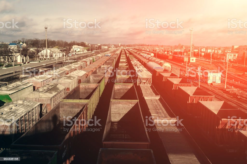 A lot of freight rail cars, a cargo distribution station. Staging...